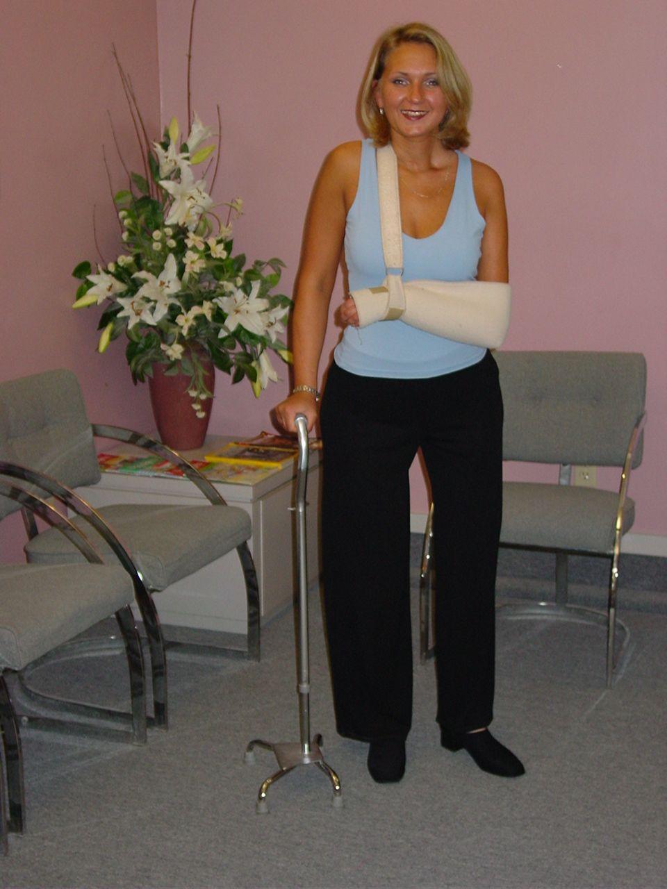 Inga standing wearing prosthetic legs
