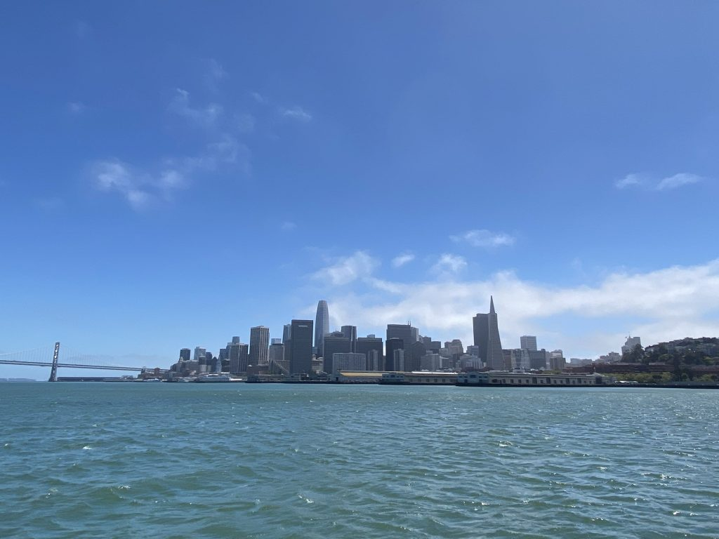 San Francisco from cruise boat, scyscrapers and Bay Bridge in the horizon