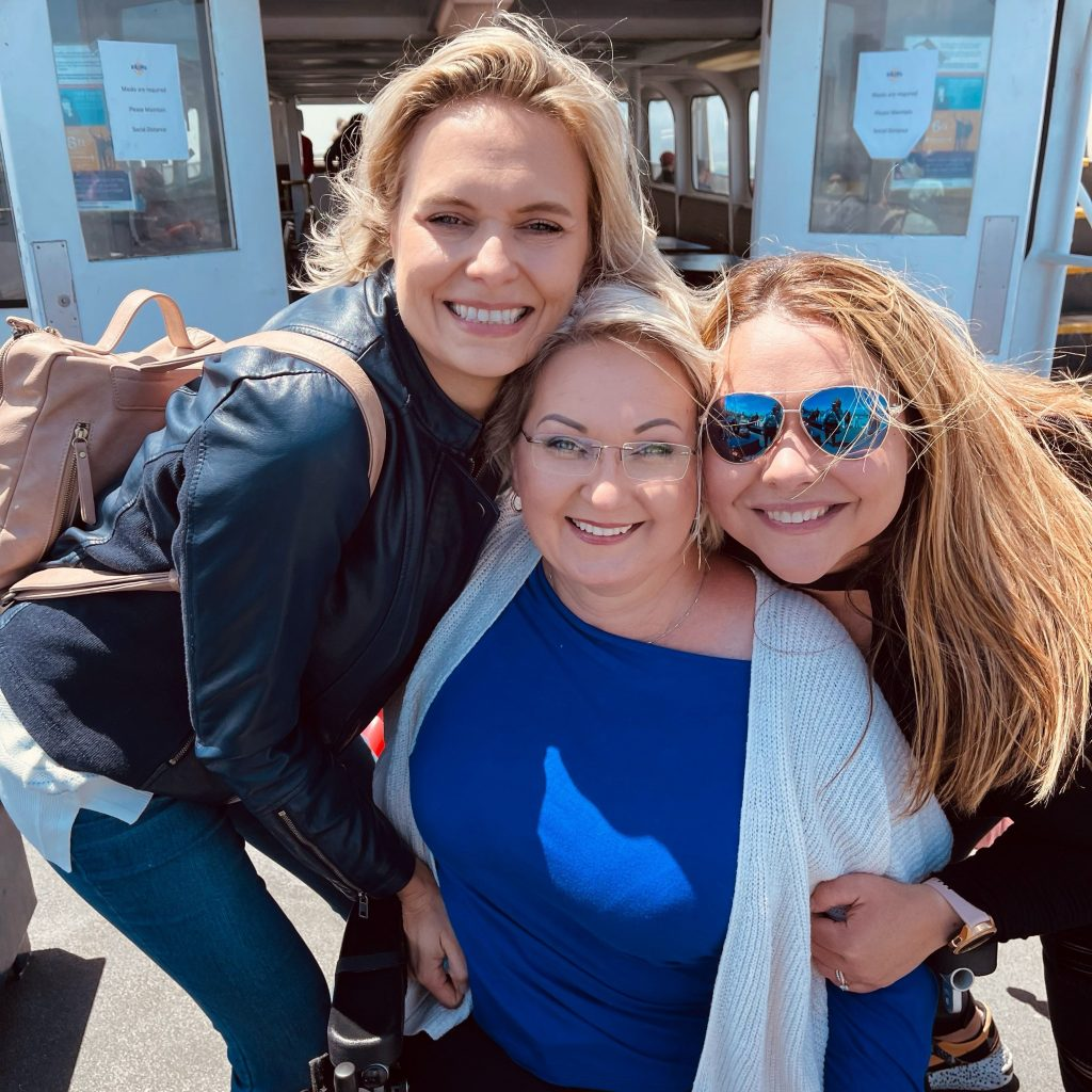 Inga Lizdenyte with her friends on a cruise boat's second floor deck