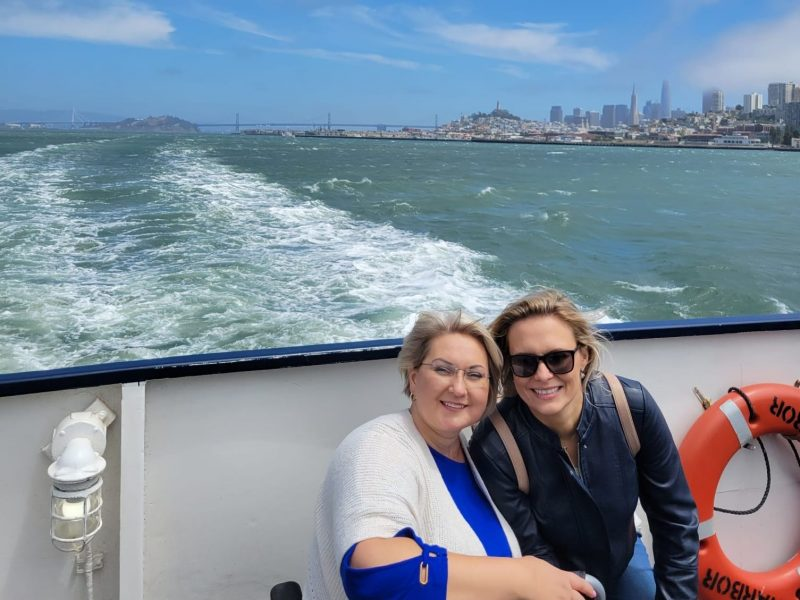 Inga Lizdenyte with her friend on the cruise boat's deck, rejoicing over overcoming obstacles